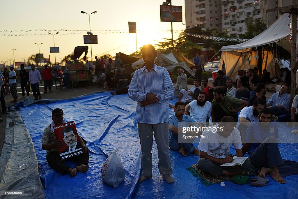 Supporters of ousted president Mohamed Morsi pray before breaking the daily Ramadan fast on the second day of Ramadan, the holy month for Muslims where many will fast from sun-up to sun-down on July 11, 2013 in Cairo, Egypt. Egypt continues to be in a state of political paralysis following the ousting of former President and Muslim Brotherhood leader Mohamed Morsi by the military. Adly Mansour, chief justice of the Supreme Constitutional Court, was sworn in as the interim head of state in a ceremony in Cairo on the morning of July 4.