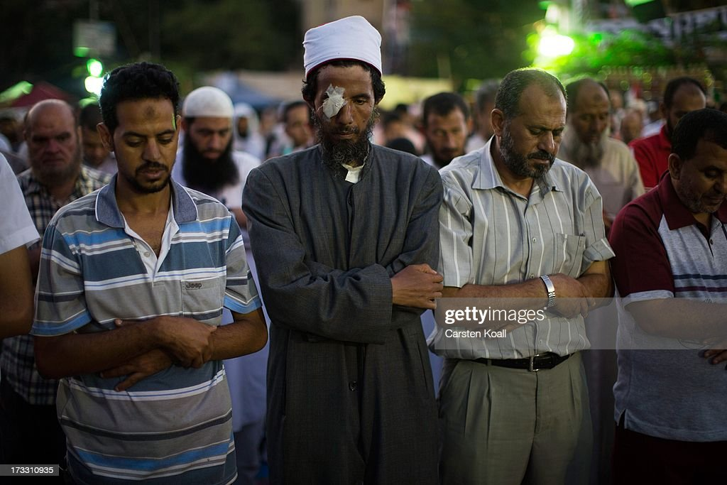 Supporters of ousted president Mohamed Morsi pray before breaking the daily Ramadan fast on the second day of Ramadan, the sacred holy month for Muslims where many will fast from sun-up to sun-down, on July 11, 2013 in Cairo, Egypt. Egypt continues to be in a state of political paralysis following the ousting of former President and Muslim Brotherhood leader Mohamed Morsi by the military. Adly Mansour, chief justice of the Supreme Constitutional Court, was sworn in as the interim head of state in a ceremony in Cairo on the morning of July 4.