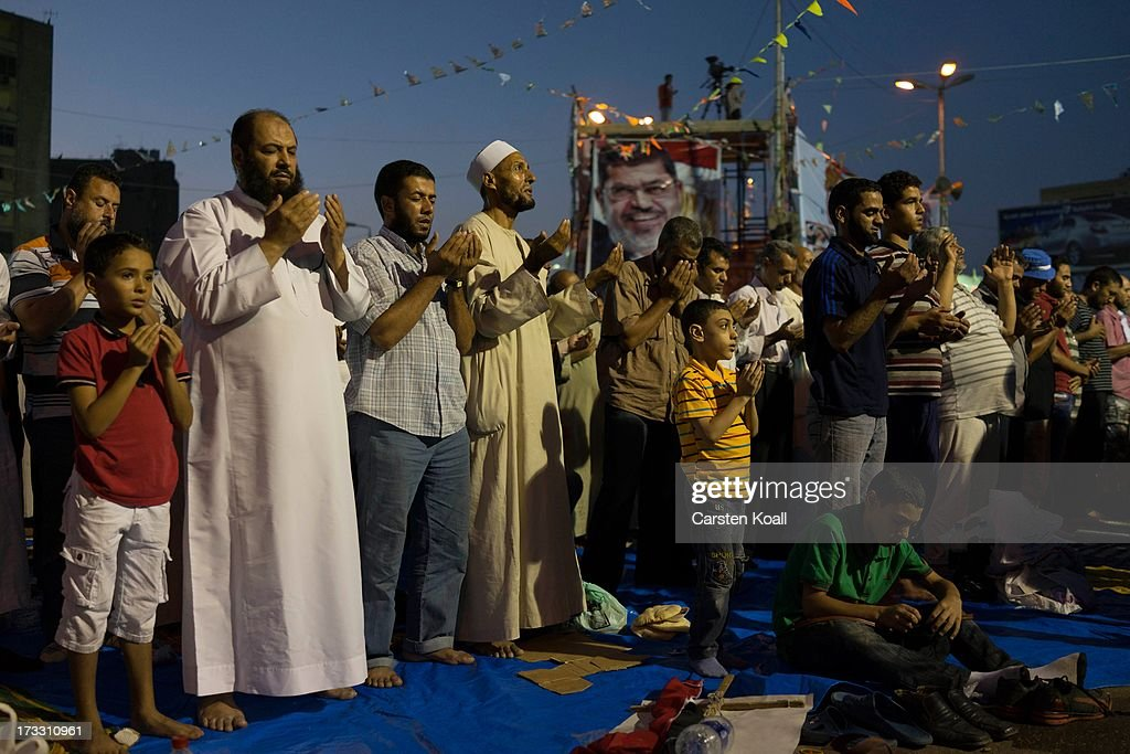 Supporters of ousted president Mohamed Morsi pray before breaking the daily Ramadan fast on the second day of Ramadan the sacred holy month for...