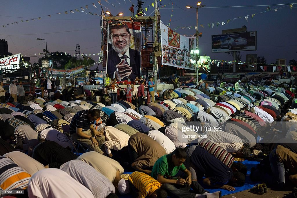 Supporters of ousted president Mohamed Morsi pray before breaking the daily Ramadan fast on the second day of Ramadan, the sacred holy month for Muslims where many will fast from sun-up to sun-down on July 11, 2013 in Cairo, Egypt. Egypt continues to be in a state of political paralysis following the ousting of former President and Muslim Brotherhood leader Mohamed Morsi by the military. Adly Mansour, chief justice of the Supreme Constitutional Court, was sworn in as the interim head of state in a ceremony in Cairo on the morning of July 4.