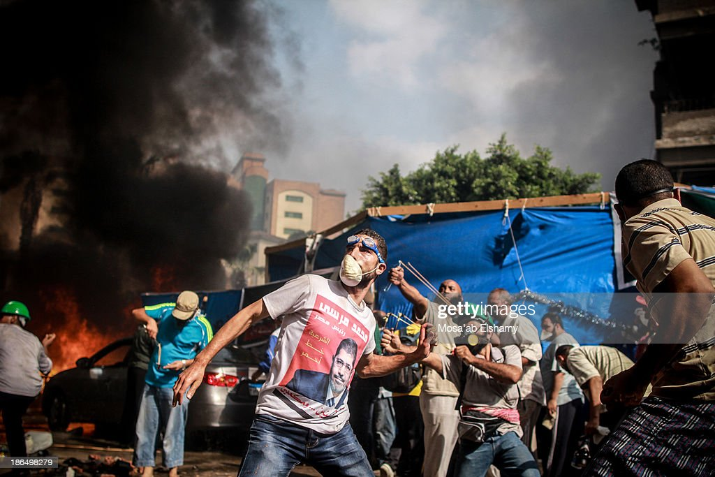 CONTENT] Supporters of ousted president Mohamed Morsi throw rocks at security forces during the violent dispersal of Rabaa Adaweya camp which left at...