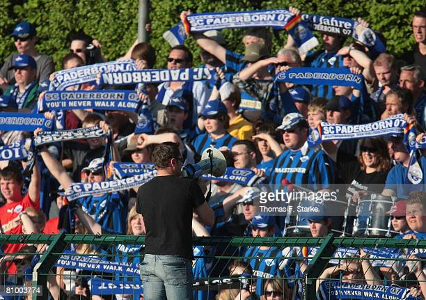 Supporters of Paderborn cheer their team during the Second Bundesliga match between SC Paderborn and 1860 Munich at the HermannLoens stadium on May...