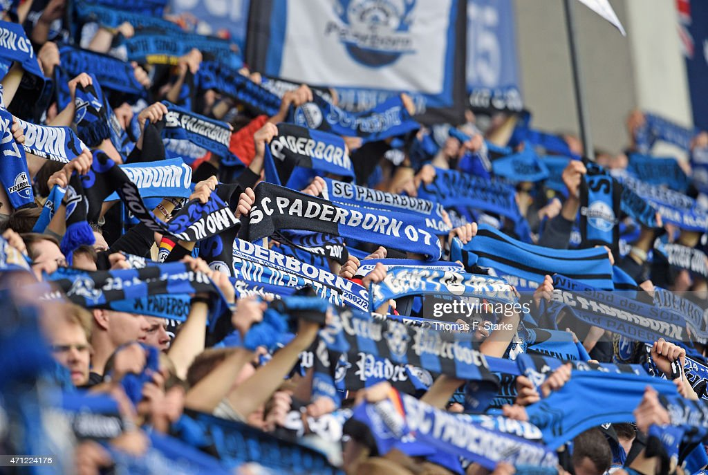 Supporters of Paderborn cheer their team prior to the Bundesliga match between SC Paderborn and SV Werder Bremen at Benteler Arena on April 26 2015...