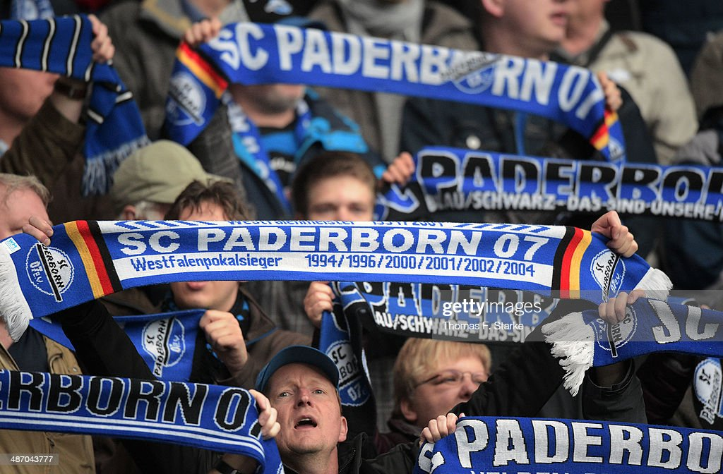 Supporters of Paderborn cheer their team prior to the Second Bundesliga match between SC Paderborn and SV Sandhausen at Benteler Arena on April 27, 2014 in Paderborn, Germany.