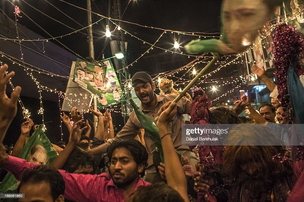 Supporters of Pakistan Muslim League-N (PMLN) celebrate election results in front of a party office late evening on May 11, 2013 in Lahore, Pakistan. Millions of Pakistanis cast their votes in parliamentary elections held today on May 11. It is the first time in the country's history that an elected government will hand over power to another elected government.