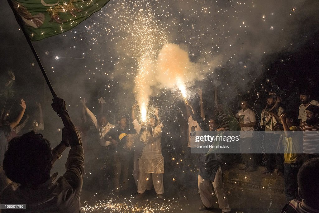 Supporters of Pakistan Muslim League-N (PMLN) celebrate election results with fireworks in front of a party office, late evening on May 11, 2013 in Lahore, Pakistan. Millions of Pakistanis cast their votes in parliamentary elections held today on May 11. It is the first time in the country's history that an elected government will hand over power to another elected government.
