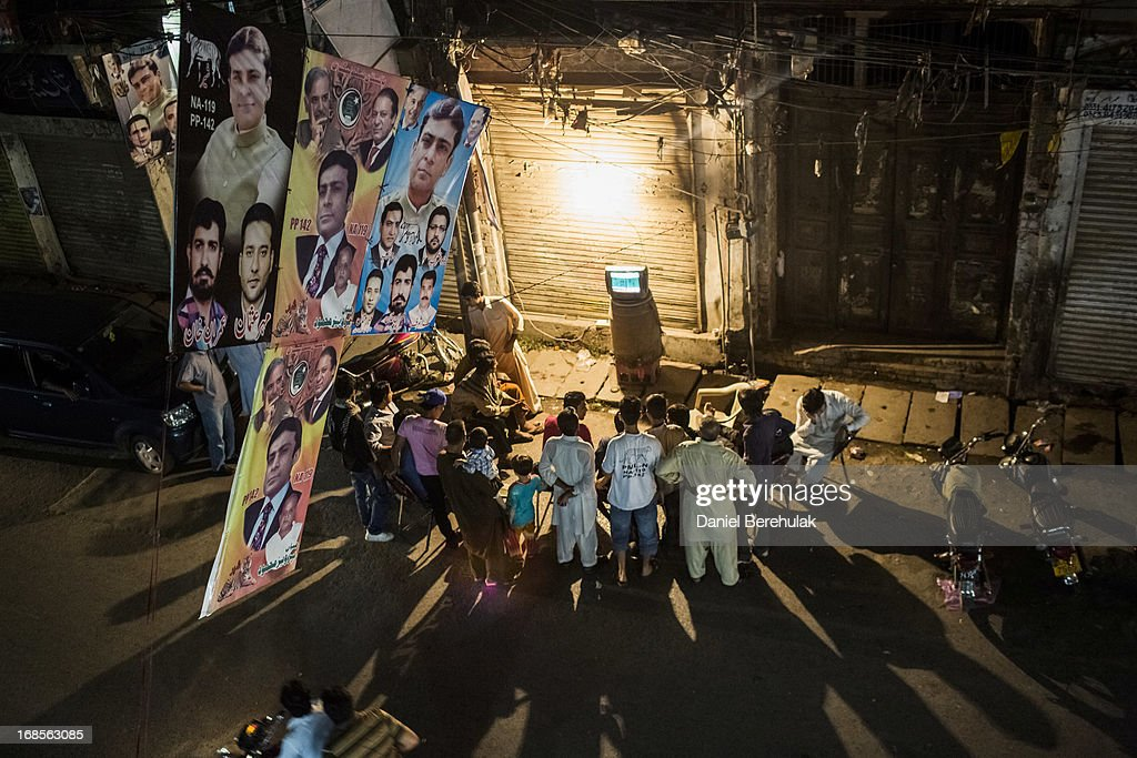 Supporters of Pakistan Muslim League-N (PMLN) watch election results on a tv set on the street on May 11, 2013 in the Old City of Lahore, Pakistan. Millions of Pakistanis cast their votes in parliamentary elections held today on May 11. It is the first time in the country's history that an elected government will hand over power to another elected government.