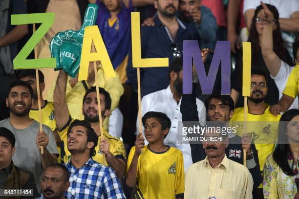 Supporters of Pakistani cricket team Peshawar Zalmi cheer for their team prior to start of the final cricket match of the Pakistan Super League...