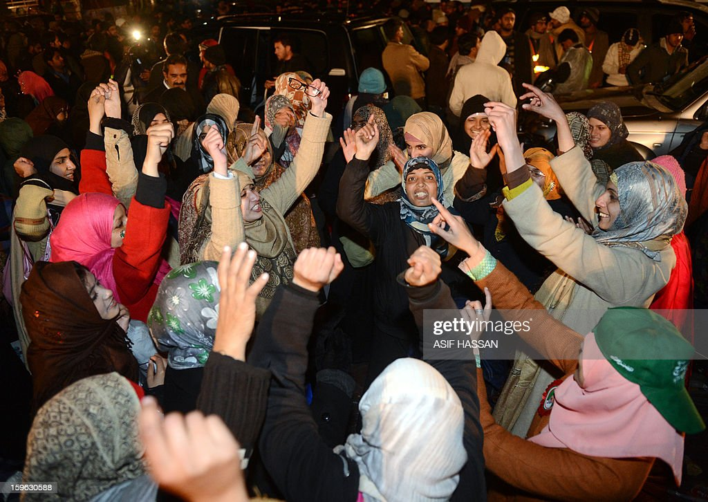 Supporters of Pakistani Muslim cleric Tahir-ul Qadri celebrate the victory of a demand for electoral reform at a protest rally in Islamabad on January 17, 2013. A populist Pakistani cleric calling for electoral reforms announced that a mass sit-in of tens of thousands of people camped outside parliament in Islamabad would end on January 17. Qadri wants parliament dissolved and a caretaker government set up in consultation with the military and judiciary to implement key reforms before free elections can be held. AFP PHOTO/ Asif HASSAN