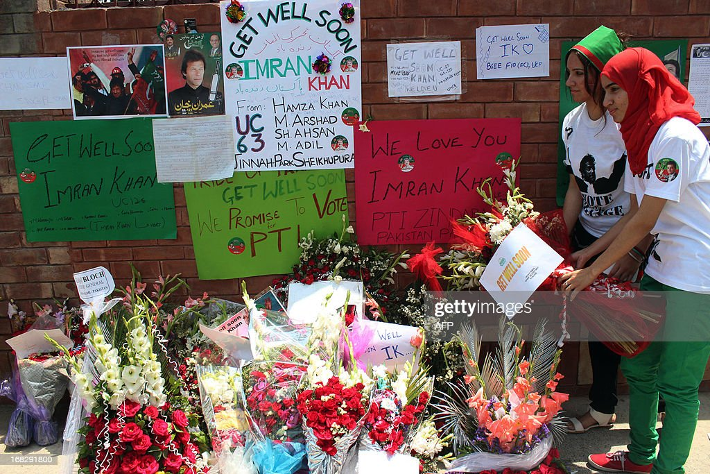 Supporters of Pakistani politician and former cricketer Imran Khan, place flowers outside a hospital where Khan is admitted in Lahore on May 8, 2013. Khan has been advised to rest for a week after sustaining skull and back injuries in a fall at an election campaign rally, a hospital official said. The former cricket star was admitted to the private Shaukat Khanum hospital that he founded in Lahore on May 7 after falling off a lift taking him to the stage at a rally ahead of Pakistan's general election on Saturday.