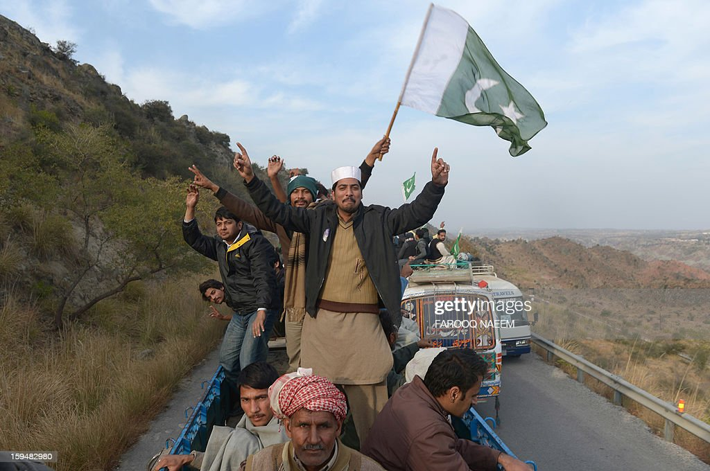 Supporters of Pakistani religious leader Tahir-ul Qadri take part in the protest march at Domeli, about 100 kms from Islamabad on January 14, 2013. Tens of thousands of Pakistani protesters streamed towards Islamabad on Monday, led by a cleric calling for revolution but accused of trying to sow political chaos ahead of elections. AFP PHOTO/Farooq NAEEM