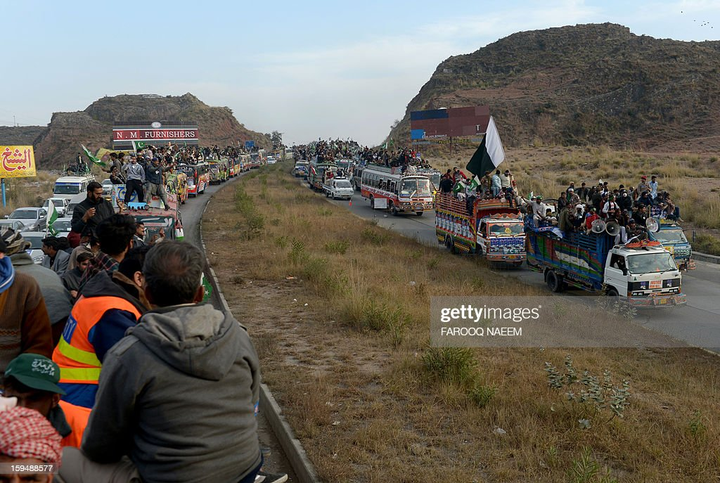 Supporters of Pakistani religious leader Tahir-ul Qadri takes part in a protest march in Sohawa, about 80 kms from Islamabad on January 14, 2013. Tens of thousands of Pakistani protesters streamed towards Islamabad on Monday, led by a cleric calling for revolution but accused of trying to sow political chaos ahead of elections. AFP PHOTO/Farooq NAEEM