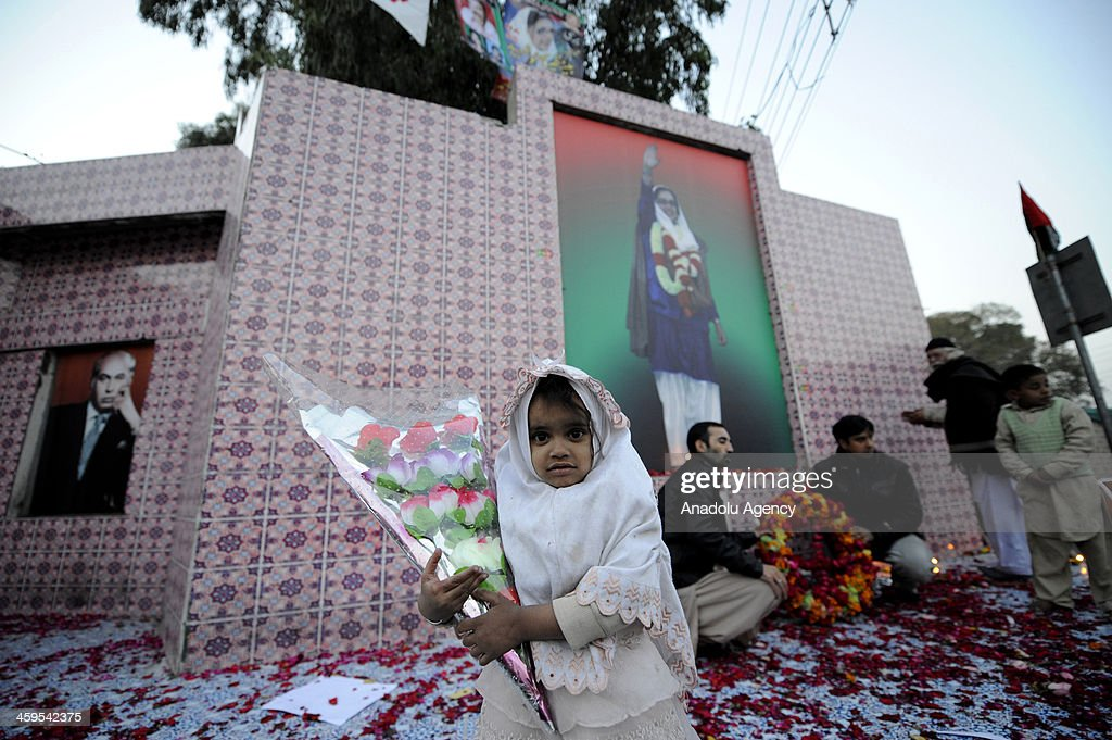 Supporters of Pakistan's Benazir Bhutto commemorate at the place where country's former prime minister was killed in Rawalpindi Pakistan December 27...
