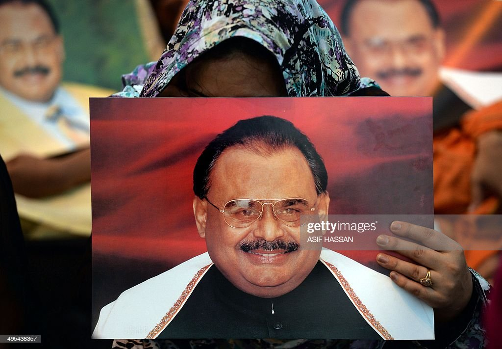 Supporters of Pakistan's Muttahida Qaumi Movement (MQM) party hold photographs of party leader <a gi-track='captionPersonalityLinkClicked' href=/galleries/search?phrase=Altaf+Hussain+-+Muttahida+Qaumi+Movement&family=editorial&specificpeople=12871789 ng-click='$event.stopPropagation()'>Altaf Hussain</a> as they stage a sit-in calling for his release in Karachi on June 3, 2014. The powerful exiled leader of Pakistan's MQM party, <a gi-track='captionPersonalityLinkClicked' href=/galleries/search?phrase=Altaf+Hussain+-+Muttahida+Qaumi+Movement&family=editorial&specificpeople=12871789 ng-click='$event.stopPropagation()'>Altaf Hussain</a>, was arrested in London on suspicion of money-laundering as thousands of people in his home city of Karachi staged a sit-in calling for his release. AFP PHOTO/Asif HASSAN