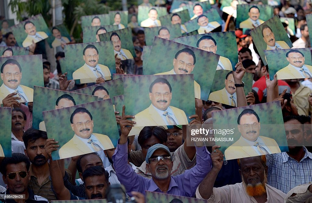 Supporters of Pakistan's Muttahida Qaumi Movement (MQM) party hold photographs of their party leader <a gi-track='captionPersonalityLinkClicked' href=/galleries/search?phrase=Altaf+Hussain+-+Muttahida+Qaumi+Movement&family=editorial&specificpeople=12871789 ng-click='$event.stopPropagation()'>Altaf Hussain</a> as they chant slogans during a gathering outside the headquarter of MQM in Karachi on June 3, 2014 following the arrest of <a gi-track='captionPersonalityLinkClicked' href=/galleries/search?phrase=Altaf+Hussain+-+Muttahida+Qaumi+Movement&family=editorial&specificpeople=12871789 ng-click='$event.stopPropagation()'>Altaf Hussain</a>, in London. The leader of Pakistan's MQM party, <a gi-track='captionPersonalityLinkClicked' href=/galleries/search?phrase=Altaf+Hussain+-+Muttahida+Qaumi+Movement&family=editorial&specificpeople=12871789 ng-click='$event.stopPropagation()'>Altaf Hussain</a>, has been arrested in London on suspicion of money-laundering, reports said on June 3 as panic spread through his home city of Karachi and protesters torched vehicles. AFP PHOTO/Rizwan TABASSUM