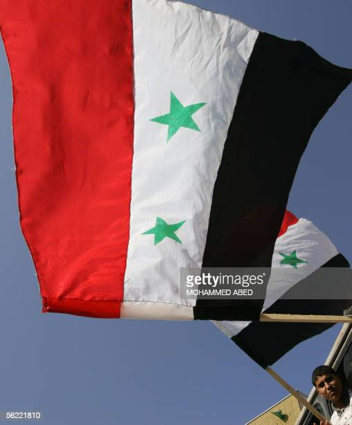 Supporters of Palestinian movement Islamic Jihad hold up Syrian flags as they arrive to a demonstration in Gaza City 18 November 2005 The Islamic...