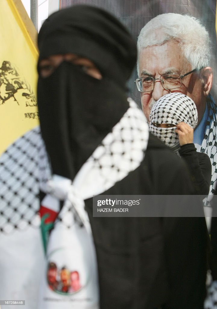 Supporters of Palestinian president Mahmud Abbas's Fatah party, gather during a rally as part of the party's election campaign at the Polytechnic University, in the West Bank city of Hebron, on April 23, 2013. The Fatah party, which dominates the West Bank, and its rival the Islamist Hamas movement, which governs the Gaza Strip, are both contesting in the upcoming general elections. AFP PHOTO/HAZEM BADER