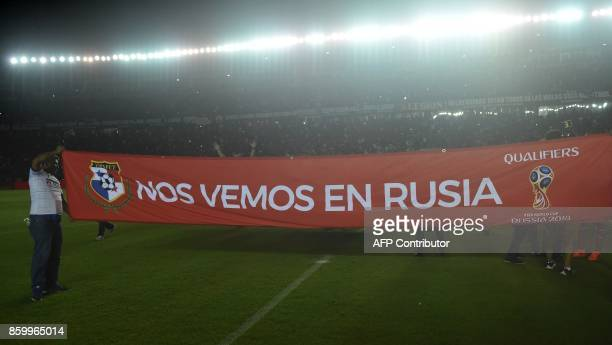 Supporters of Panama hold a banner reading 'We'll see you in Russia' after their team defeated Costa Rica and qualified for the World Cup for the...