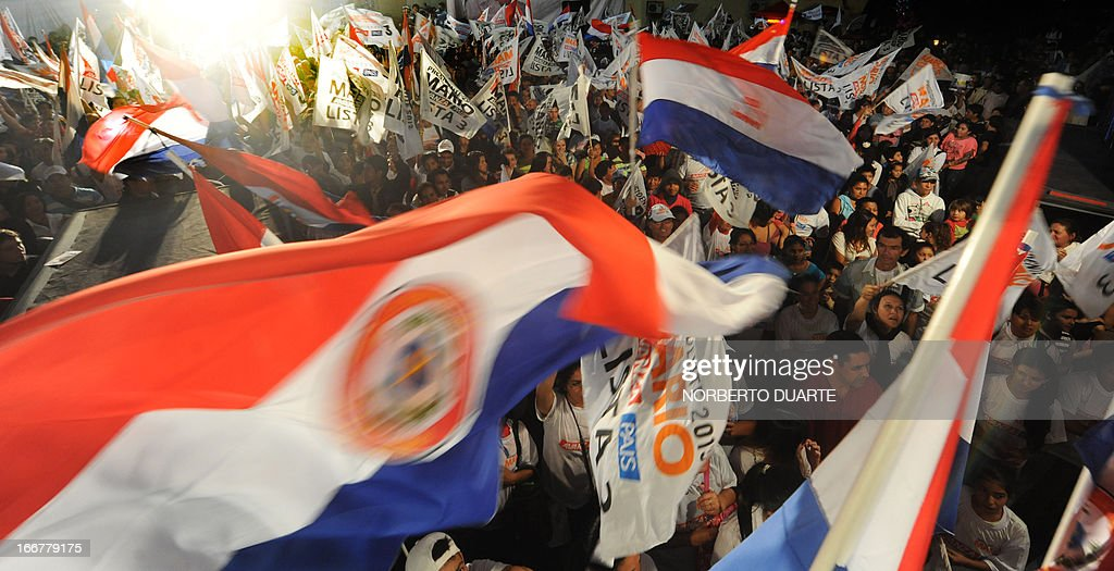 Supporters of Paraguayan presidential candidate for the Avanza Pais party Mario Ferreiro cheer during the closing rally of the Avanza Pais party's campaign in Asuncion on April 16, 2013 AFP PHOTO PABLO Burgos