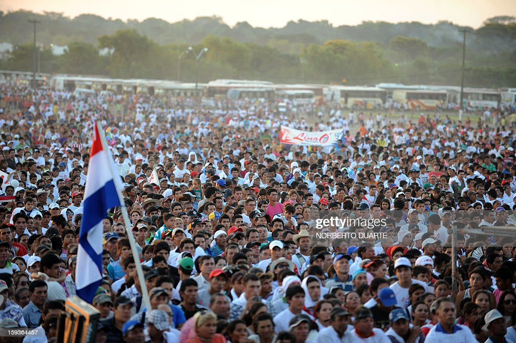 Supporters of Paraguayan presidential candidate for the National Union of Ethical Citizens (UNACE) party, Lino Oviedo, are seen during a rally for the initiation of his political campaign in Luque, Paraguay on, January 12 , 2013. Paraguay will hold presidential elections on April 21, 2013. AFP PHOTO/Norberto Duarte