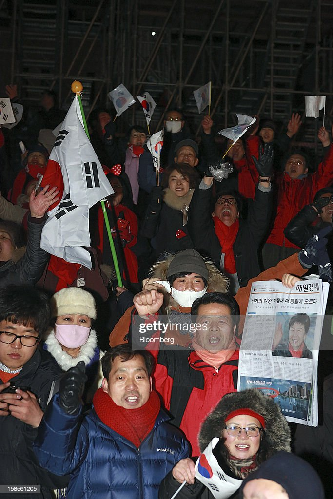 Supporters of Park Geun Hye, the president-elect from the ruling New Frontier Party, celebrate in Seoul, South Korea, on Thursday, Dec. 20, 2012. Park was elected president of South Korea, becoming the first woman to lead Asia's fourth- biggest economy more than 30 years after her father's reign as dictator ended with his assassination. Photographer: Jean Chung/Bloomberg via Getty Images