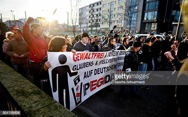 Supporters of Pegida Hogesa and other rightwing populist groups gather to protest against the New Year's Eve sex attacks on January 9 2016 in Cologne...