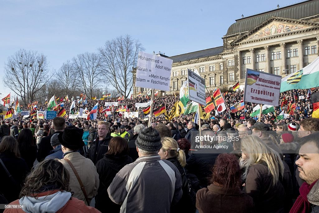 Supporters of Pegida (Patriotic Europeans against the Islamization of the West) hold banners during a demonstration called 'Patriotic's day' at Konigsufer square in Dresden, Germany on February 6, 2016.