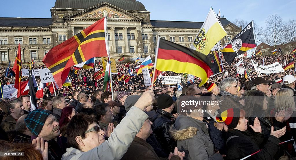 Supporters of Pegida (Patriotic Europeans against the Islamization of the West) hold flags during a demonstration called 'Patriotic's day' at Konigsufer square in Dresden, Germany on February 6, 2016.