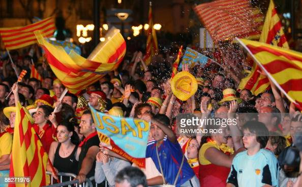 Supporters of Perpignan rugby club celebrate after their team won the Top 14 final rugby match against ClermontFerrand on June 6 2009 in Perpignan...