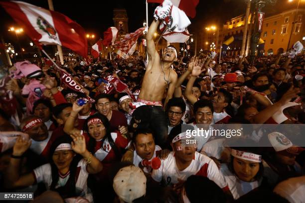 TOPSHOT Supporters of Peru celebrate a goal against New Zealand during the 2018 World Cup qualifying playoff second leg football match at the Plaza...