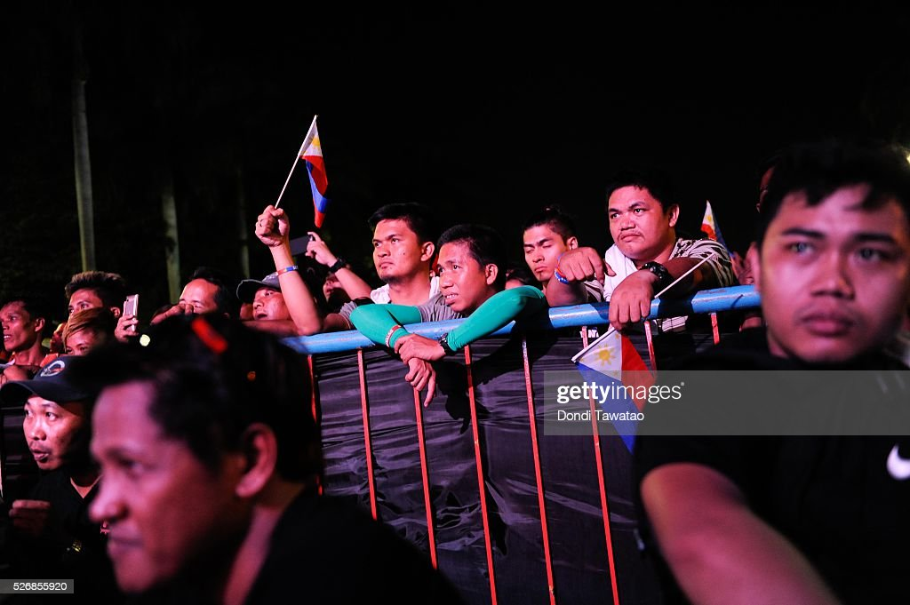 Supporters of Philippine presidential candidate Rodrigo Duterte listen to his speech during a labor day campaign rally on May 1, 2016 in Manila, Philippines. Duterte, a tough-talking mayor of Davao in Mindanao has been the surprise pre-election poll favourite pulling away from his rivals despite controversial speeches and little national government experience. Opinion polls has shown Mr Duterte has maintained his lead with 33 percent support in the Philippines as Senator Grace Poe looks at impossible odds, with only 22 percent supporting her. The Philippine presidential campaign ends on May 7 with elections slated for May 9 and features 5 presidential candidates vying for the top post.