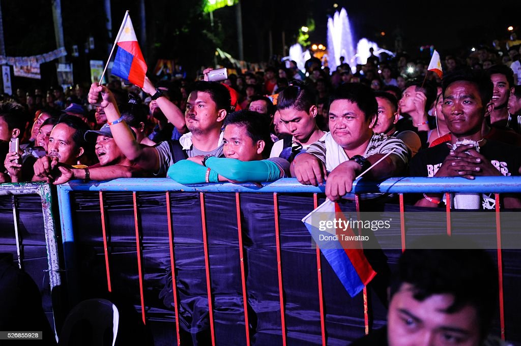 Supporters of Philippine presidential candidate Rodrigo Duterte listens to his speech during a labor day campaign rally on May 1, 2016 in Manila, Philippines. Duterte, a tough-talking mayor of Davao in Mindanao has been the surprise pre-election poll favourite pulling away from his rivals despite controversial speeches and little national government experience. Opinion polls has shown Mr Duterte has maintained his lead with 33 percent support in the Philippines as Senator Grace Poe looks at impossible odds, with only 22 percent supporting her. The Philippine presidential campaign ends on May 7 with elections slated for May 9 and features 5 presidential candidates vying for the top post.