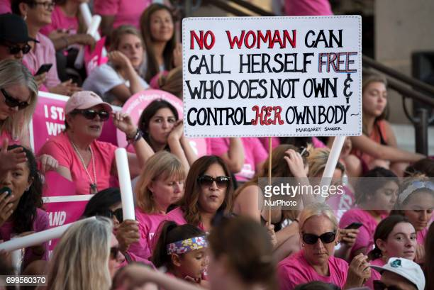 Supporters of Planned Parenthood gather to call on Congress not to ban people on Medicaid from receiving care at Planned Parenthood health centers...