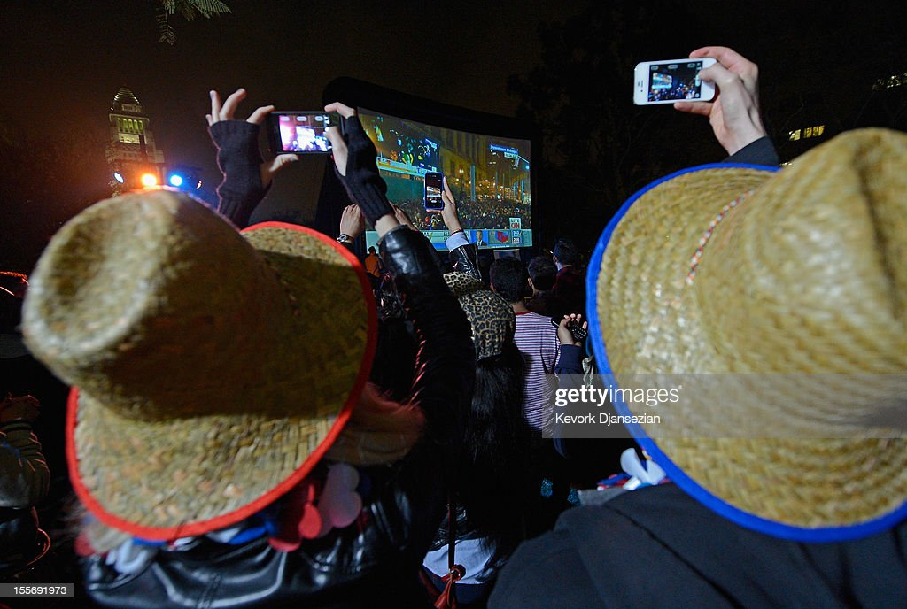 Supporters of President Barack Obama celebrate at Grand Park after Obama was re-elected on November 6, 2012 in Los Angeles, California. Obama won re-election against Republican candidate, former Massachusetts Governor Mitt Romney.