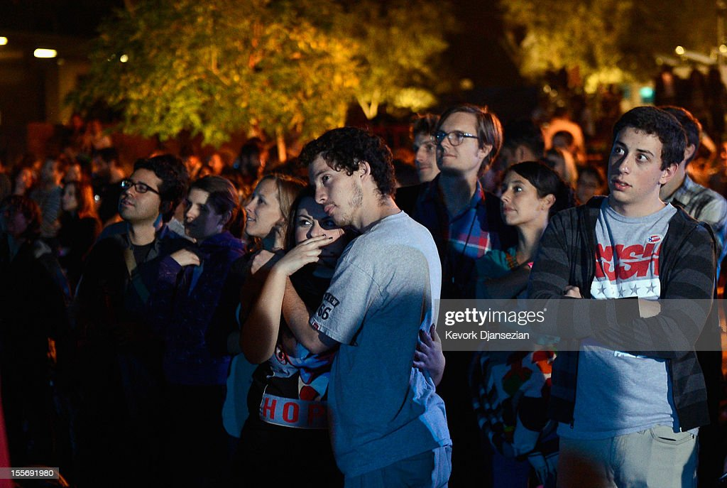 Supporters of President Barack Obama listen to the concession speech of Republican Presidential nominee Mitt Romney at Grand Park after Obama was re-elected on November 6, 2012 in Los Angeles, California. Obama won re-election against Republican candidate, former Massachusetts Governor Mitt Romney.