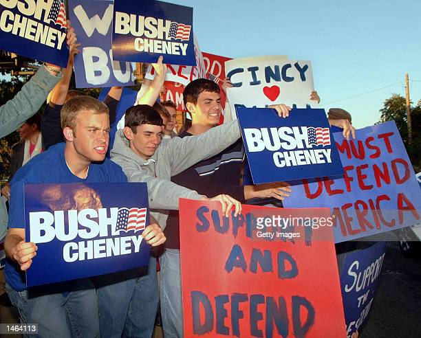 Supporters of President Bush yell at passing traffic before US President George W Bush's speech October 7 2002 in Cincinnati Ohio Approx 300 bush...