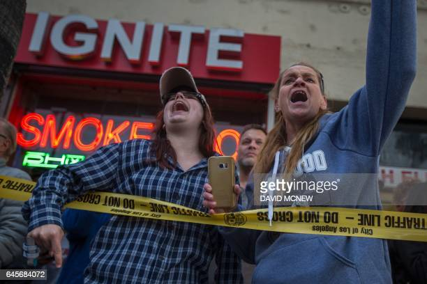 TOPSHOT Supporters of President Donald Trump yell at people marching to protest the Dakota Access Pipeline on Hollywood Boulevard near the site of...