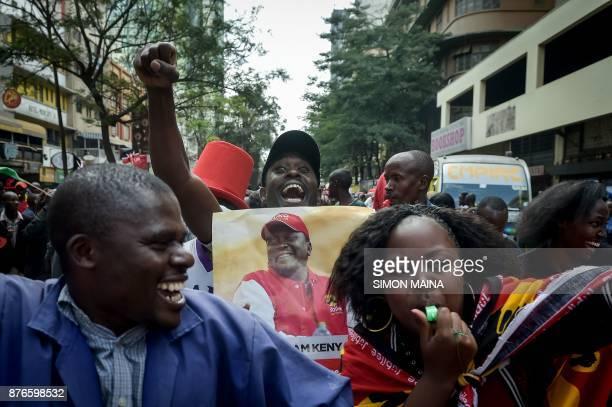 Supporters of President Uhuru Kenyatta celebrate on November 20 2017 in Nairobi after Kenya's Supreme Court dismissed two petitions to overturn the...