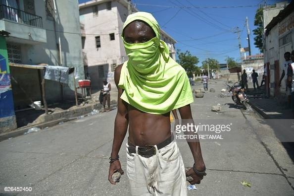 Supporters of presidential candidate Maryse Narcisse protest in the neighborhood of La Saline in the Haitian capital PortauPrince on November 29 2016...