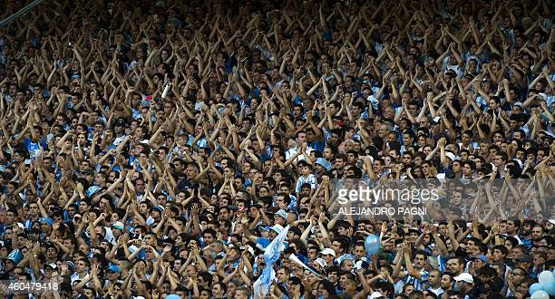 Supporters of Racing Club cheer their team during their Argentine First Division football match against Godoy Cruz at Presidente Juan Domingo Peron...
