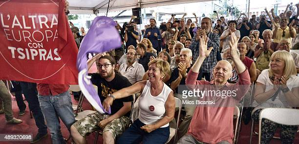 Supporters of radical leftist Syriza party Alexis Tsipras cheer at exit poll results on September 20 2015 in Athens Greece In Greece's fifth general...