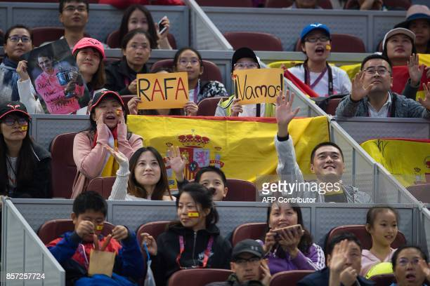 Supporters of Rafael Nadal of Spain give support during his men's singles match against Lucas Pouille of France at the China Open tennis tournament...