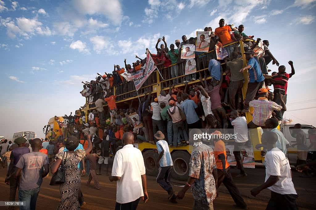 Supporters of Raila Odinga are pictured here travelling home on a lorry after a major rally in Kisumu town on March, 2013. Kisumu town is the home of Kenyan Prime Minister Raila Odinga, and a hotbed of support for ODM and CORD. Kenya is to hold general elections on March 4. AFP PHOTO/Will Boase