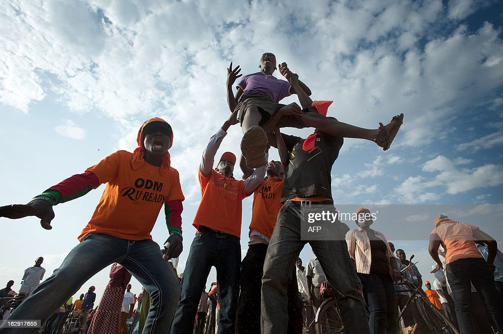 Supporters of Raila Odinga celebrate as Raila takes the stage during a major rally in Kisumu town on March, 2013. Kisumu town is the home of Kenyan Prime Minister Raila Odinga, and a hotbed of support for ODM and CORD. Kenya is to hold general elections on March 4. AFP PHOTO/Will Boase