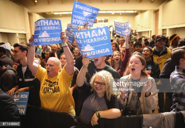 Supporters of Ralph Northam the Democratic candidate for governor of Virginia celebrate as early projections indicated a Northam victory at an...
