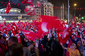 Supporters of Recep Tayyip Erdogan Turkey's president wave Turkish national flags during a progovernment demonstration at Taksim Square in Istanbul...