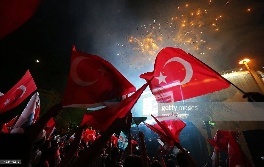 Supporters of Recep Tayyip Erdogan winner of Turkish Presidential election according to unofficial results celebrate the election results with...