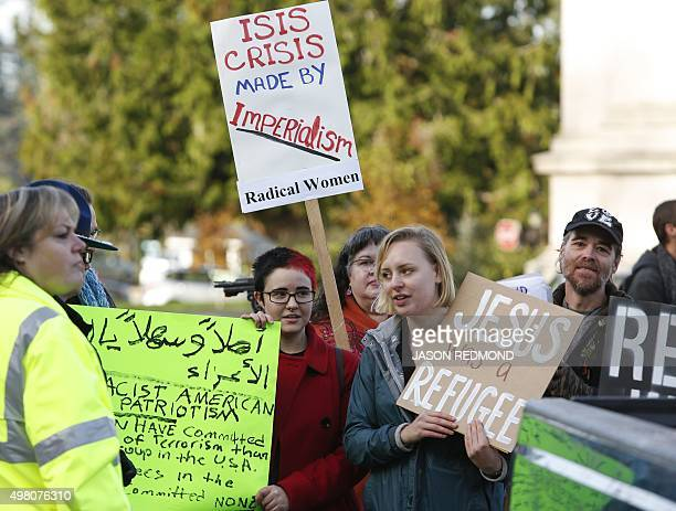 Supporters of refugees counterprotest an antirefugee group gathered on the steps of the state capitol to protest Gov Jay Inslee's welcoming of all...