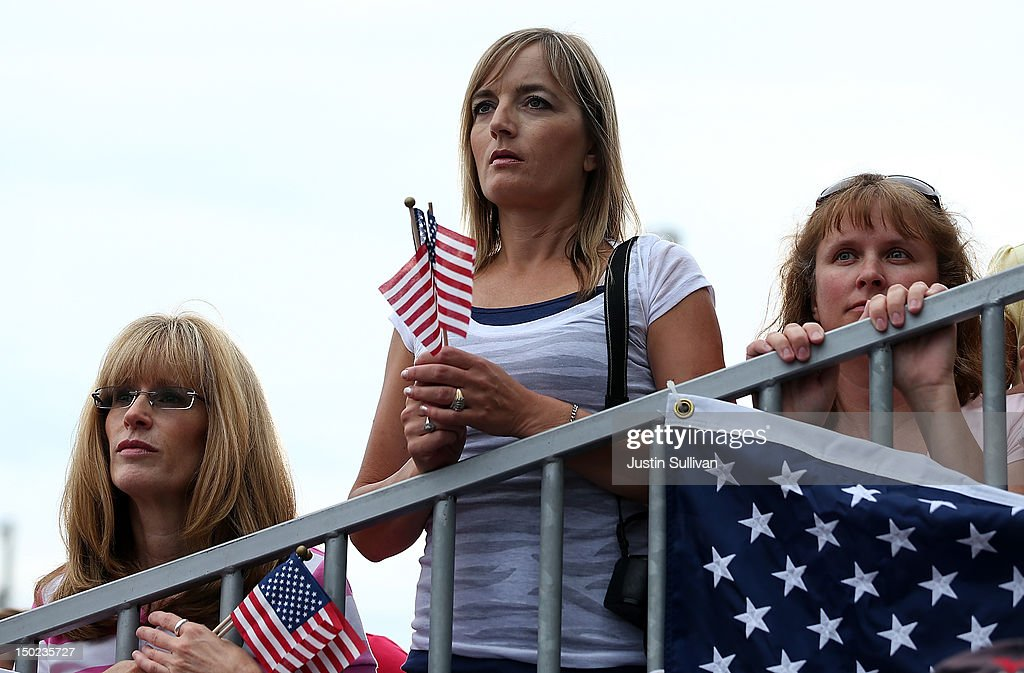Supporters of Republican presidential candidate and former Massachusetts Governor Mitt Romney and his running mate Rep. Paul Ryan (R-WI) look on during a campaign rally at the Waukesha County Expo Center on August 12, 2012 in Waukesha, Wisconsin. Mitt Romney continues his four day bus tour a day after announcing his running mate, Rep. Paul Ryan (R-WI).