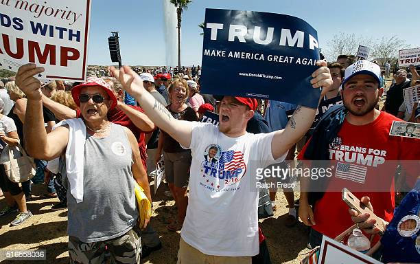 Supporters of Republican presidential candidate Donald Trump hold signs and chant his name during a campaign rally at Fountain Park during a campaign...